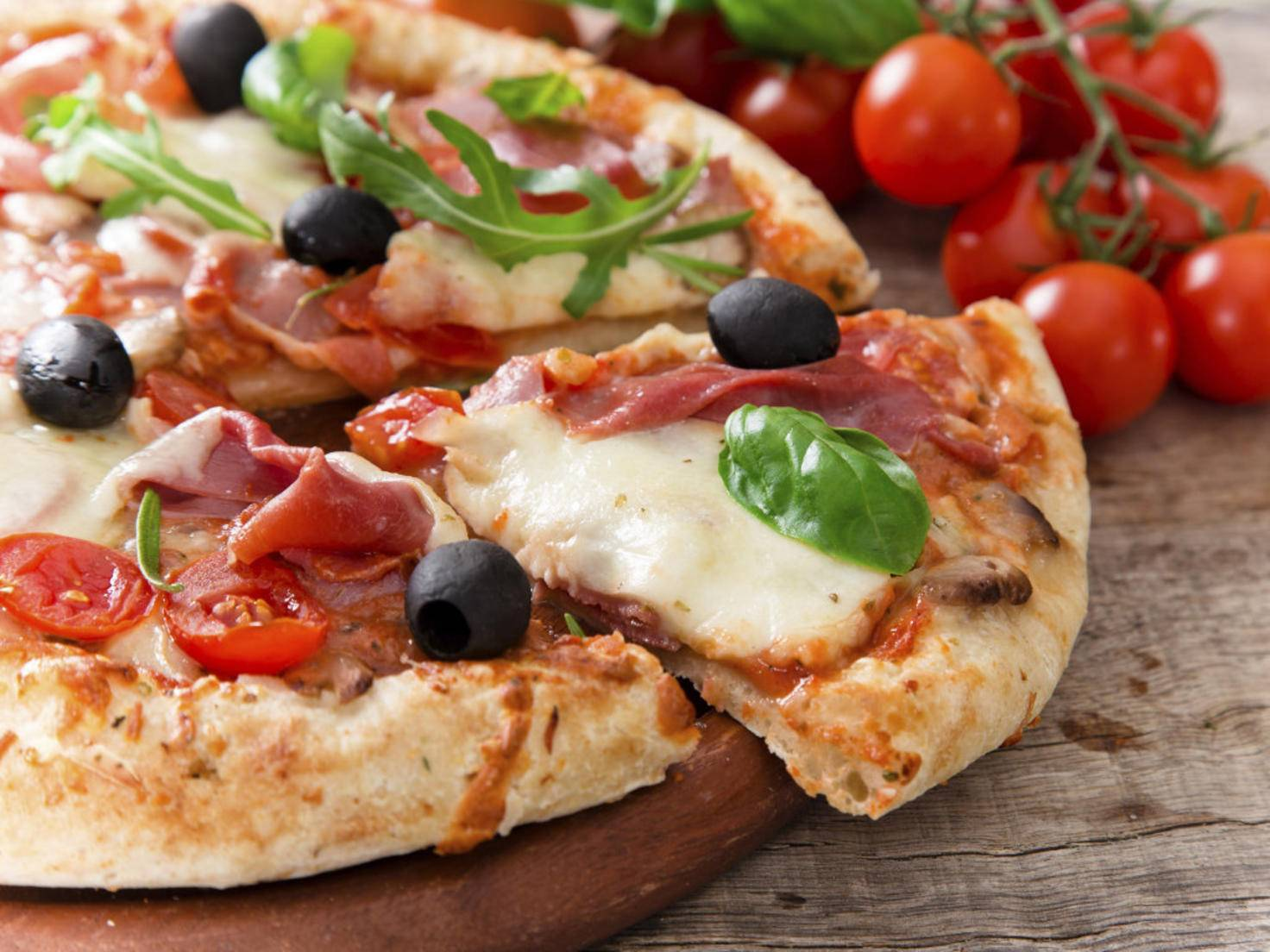Eine App verrät nun auch auf der Smartwatch, wie weit die bestellte Pizza ist.