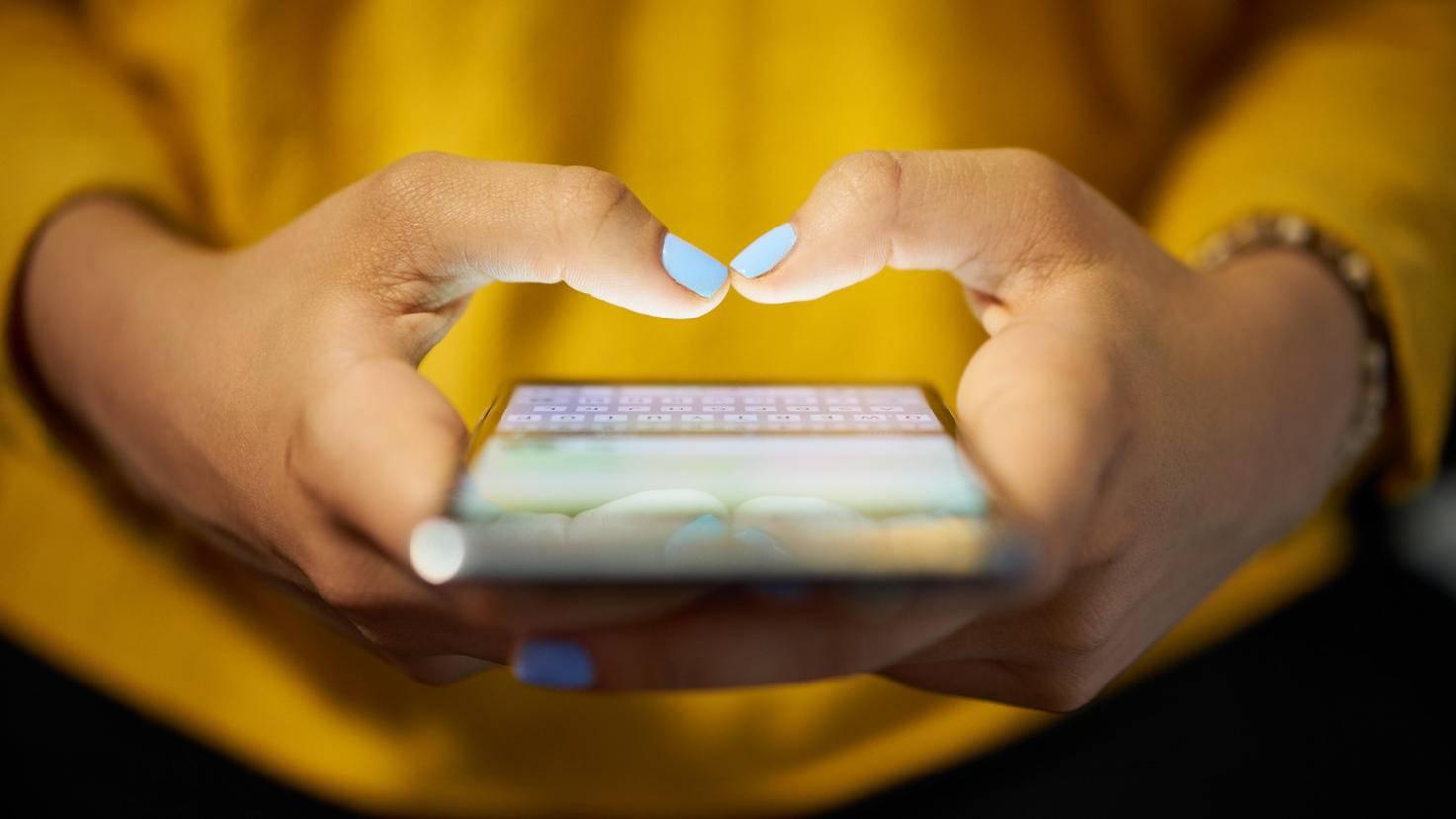 Smartphone Hand 598912704 iStock