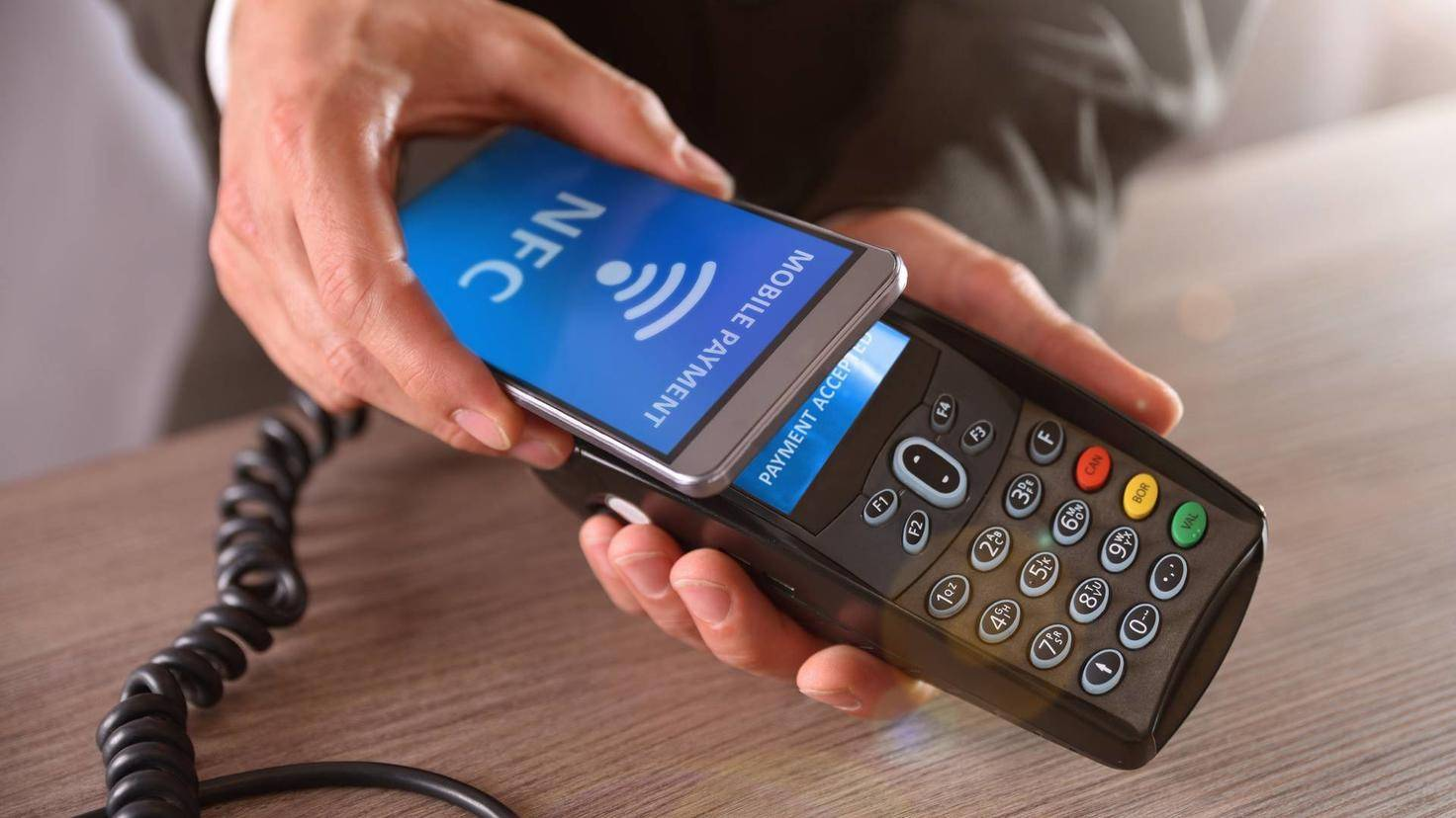 Businessman paying through mobile NFC technology