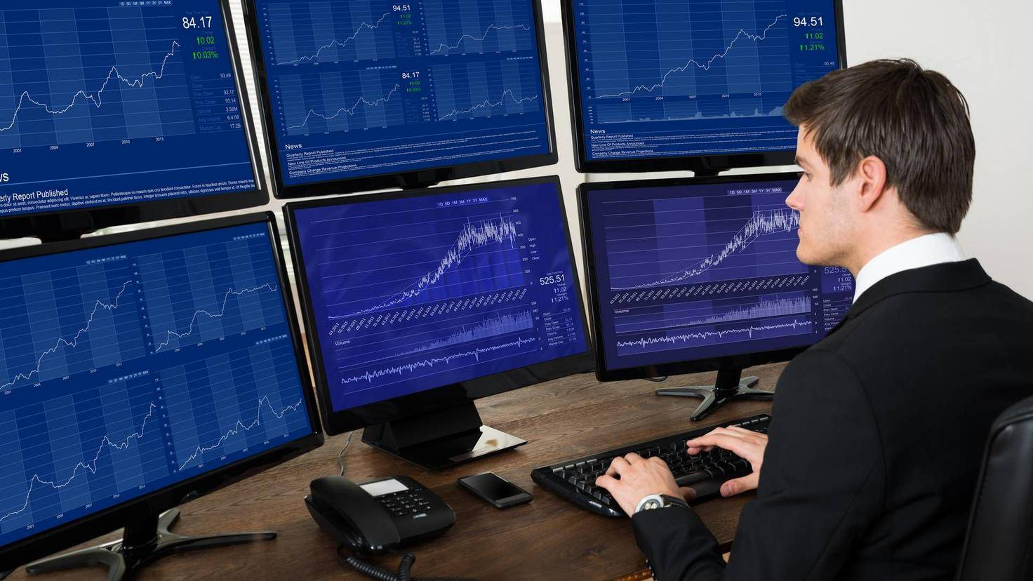 Businessman Working With Graphs On Computers