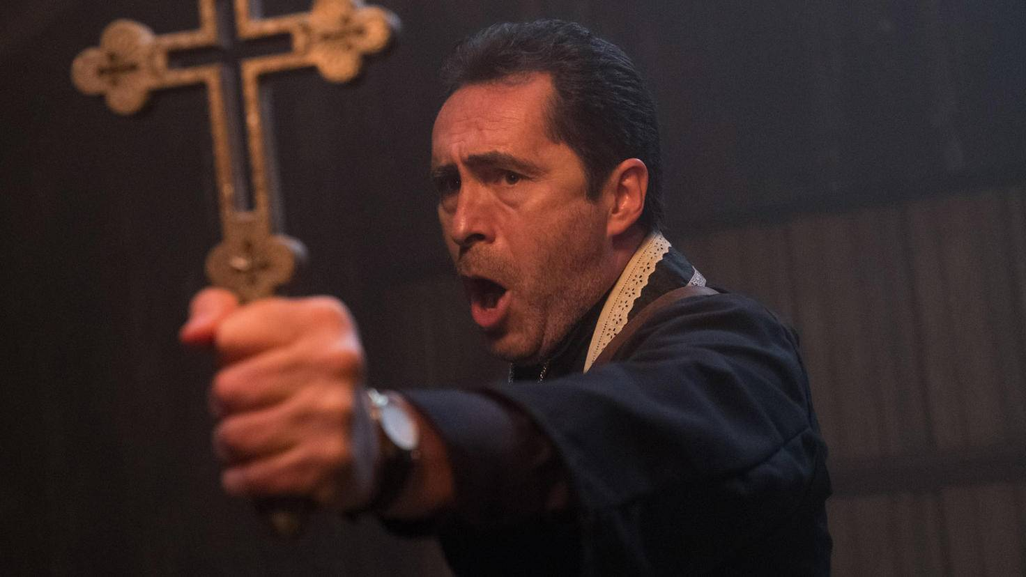 The Nun-Demian Bichir-Father Burke-Justin Use-Courtesy of Warner Bros Pictures
