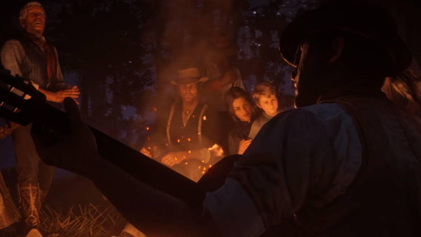 John, Abigail und Jack Marston sitzen im Trailer am Lagerfeuer.