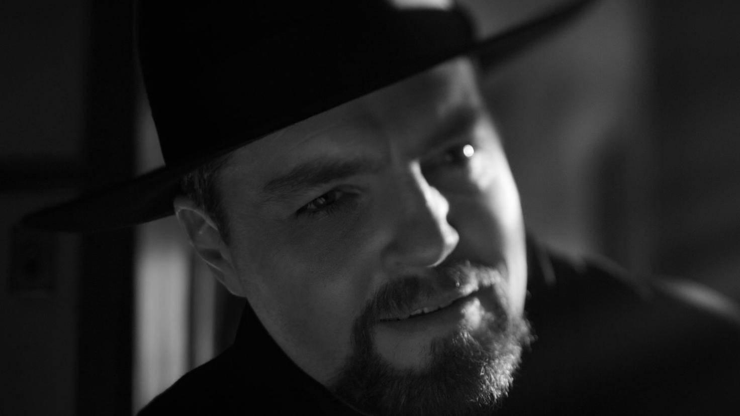 Mank Tom Burke als Orson Welles