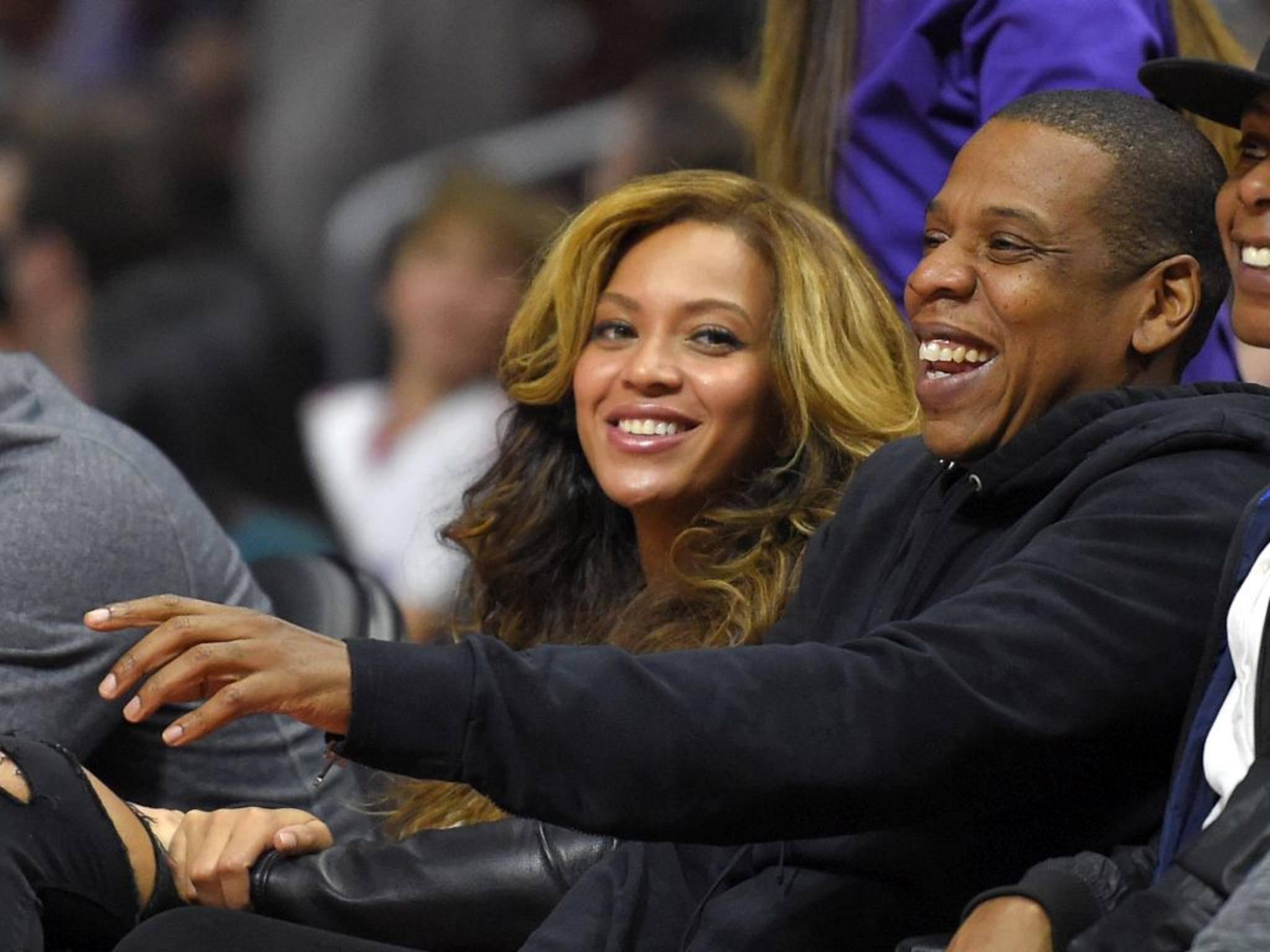Die beiden haben gut lachen: Jay-Z und Beyonce wird nun auch ein Musikdienst gehören.