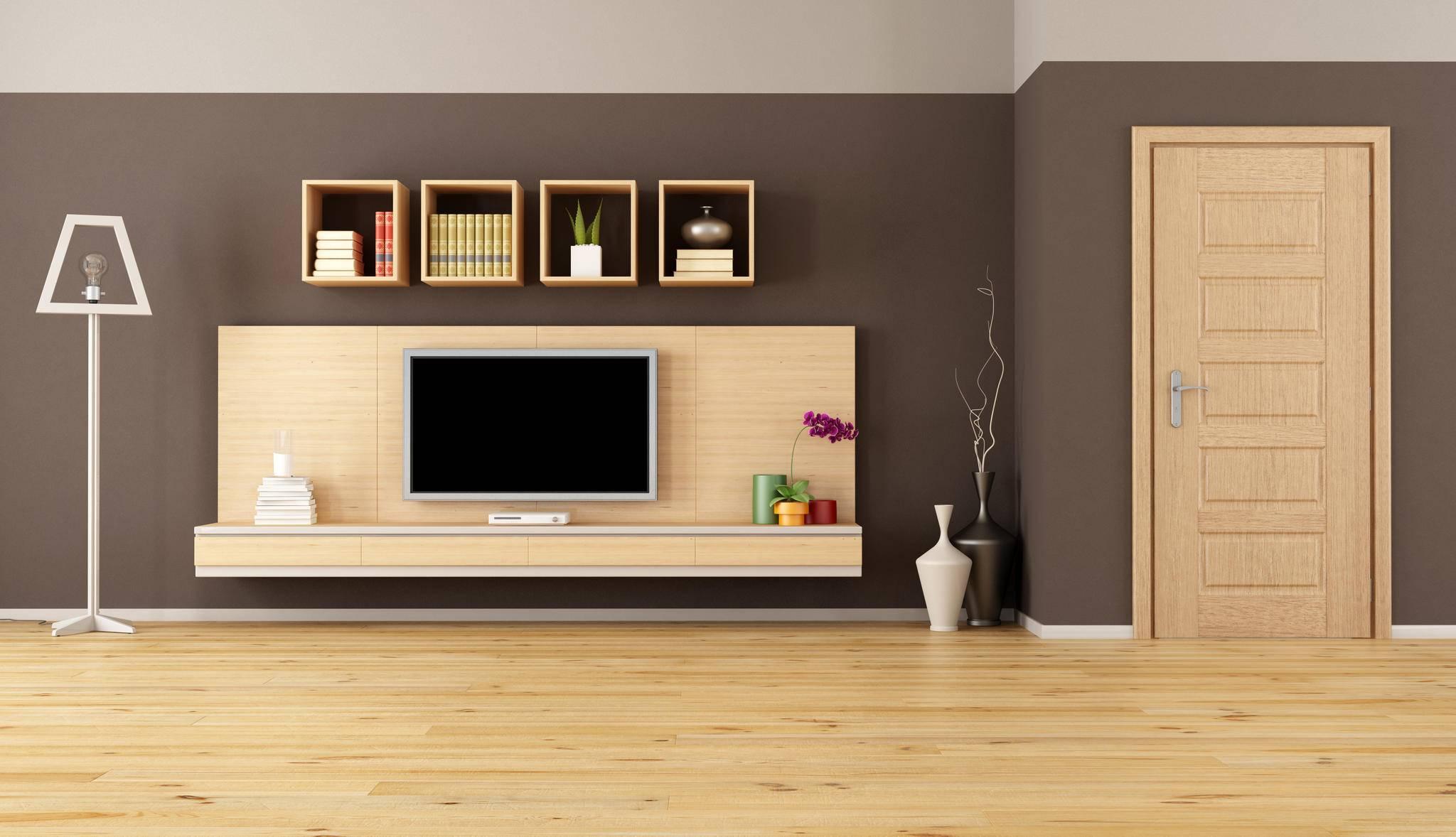 Ein Fernseher kann mit dem richtigen Schrank schön ins Wohnzimmer integriert werden.