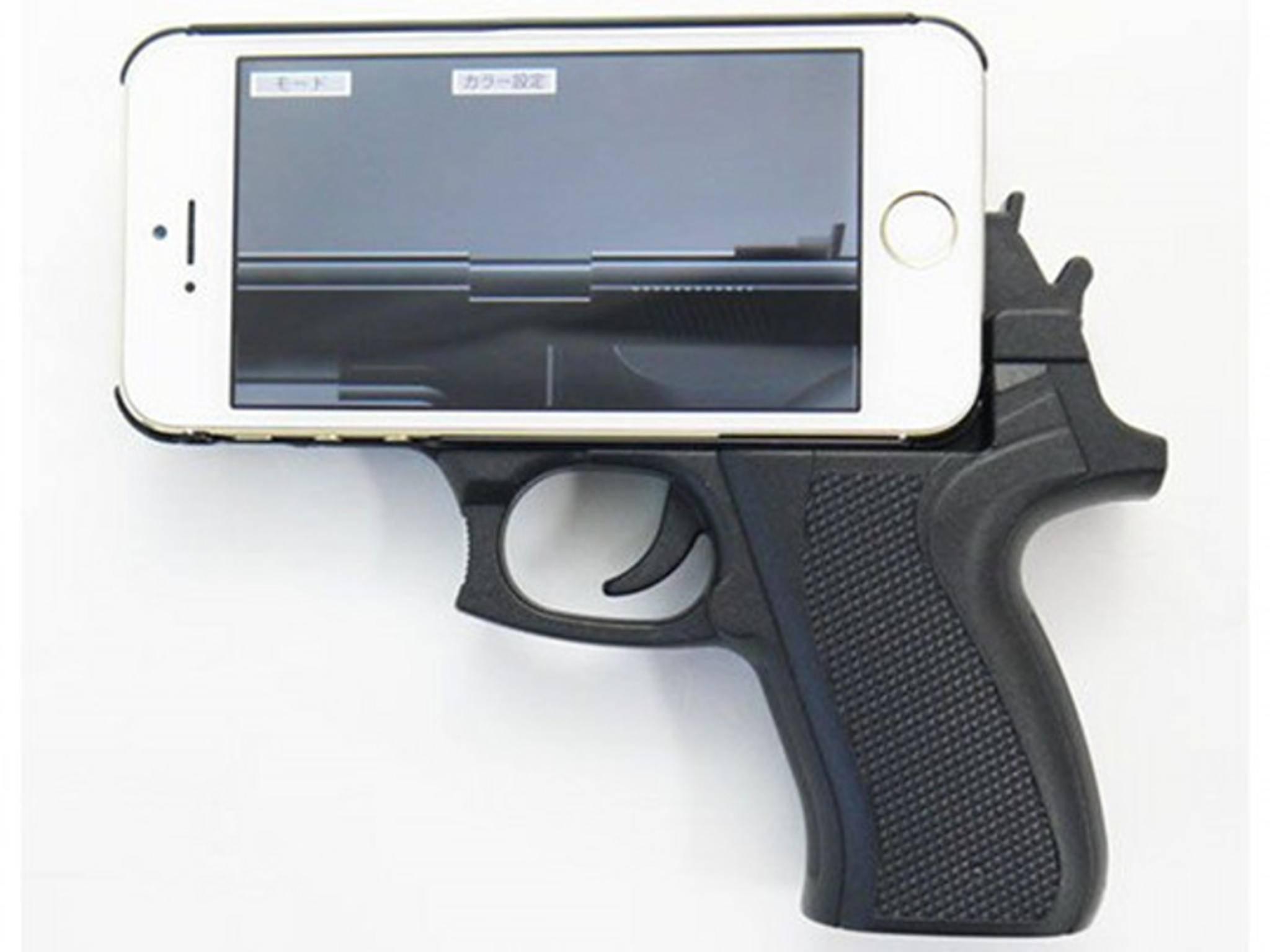 Gehören nicht zusammen: iPhones und Schusswaffen.