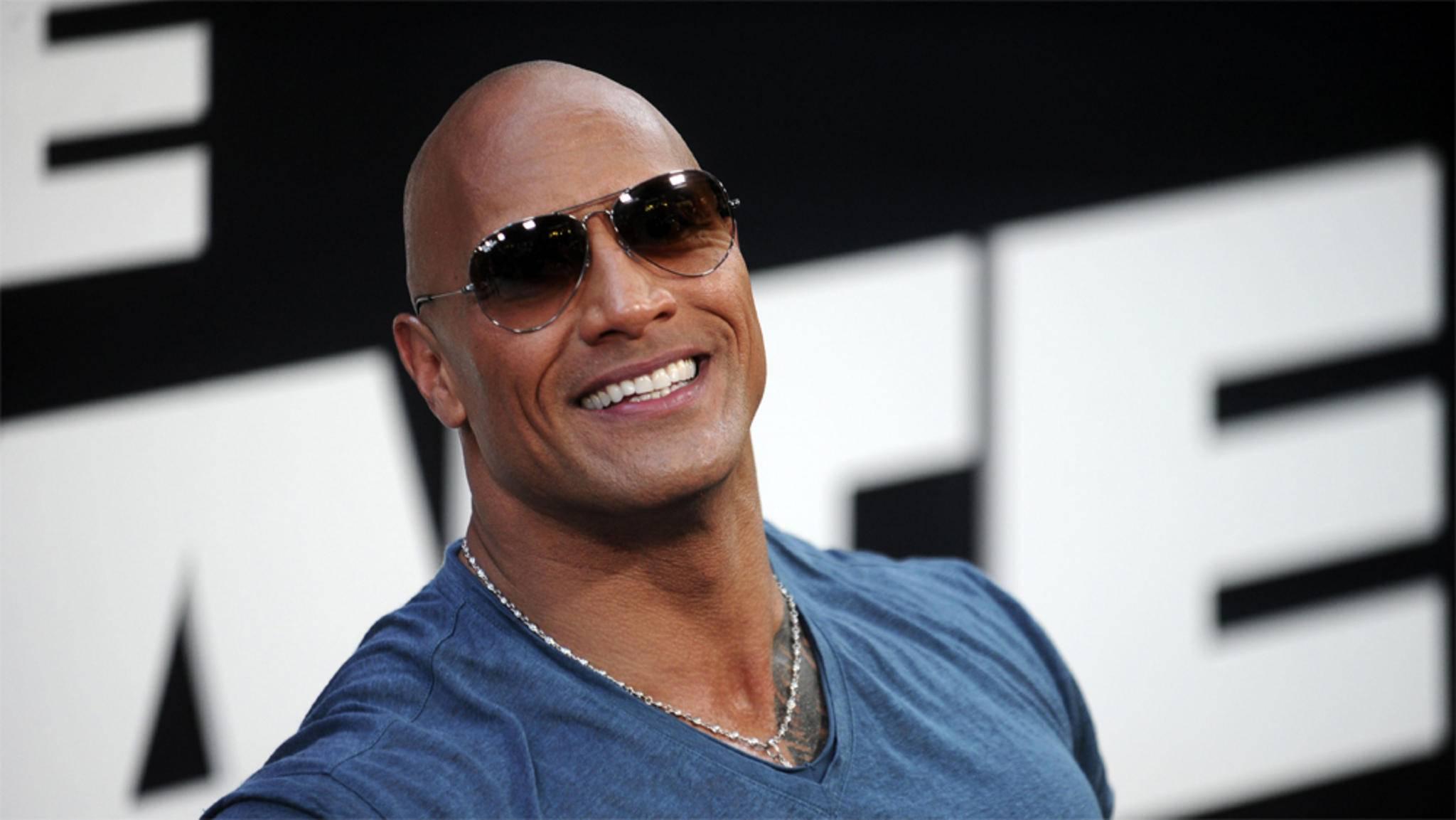 """Die Dollarzeichen in seinen Augen verbirgt Großverdiener Dwayne """"The Rock"""" Johnson geschickt hinter einer Sonnenbrille."""