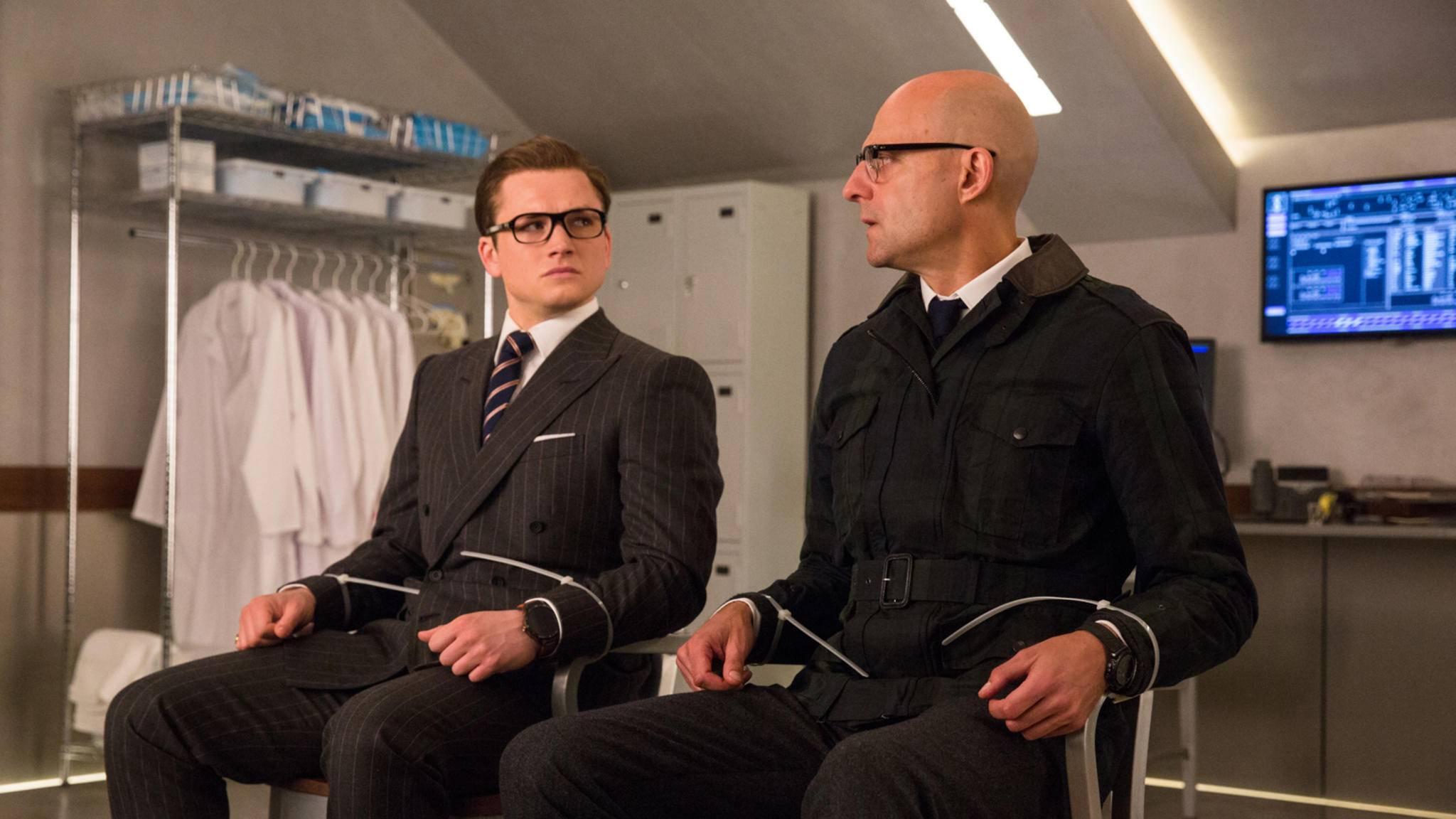 Eggsy (Taron Egerton, links) und Merlin (Mark Strong, rechts) bekommen im Sequel musikalische Verstärkung.
