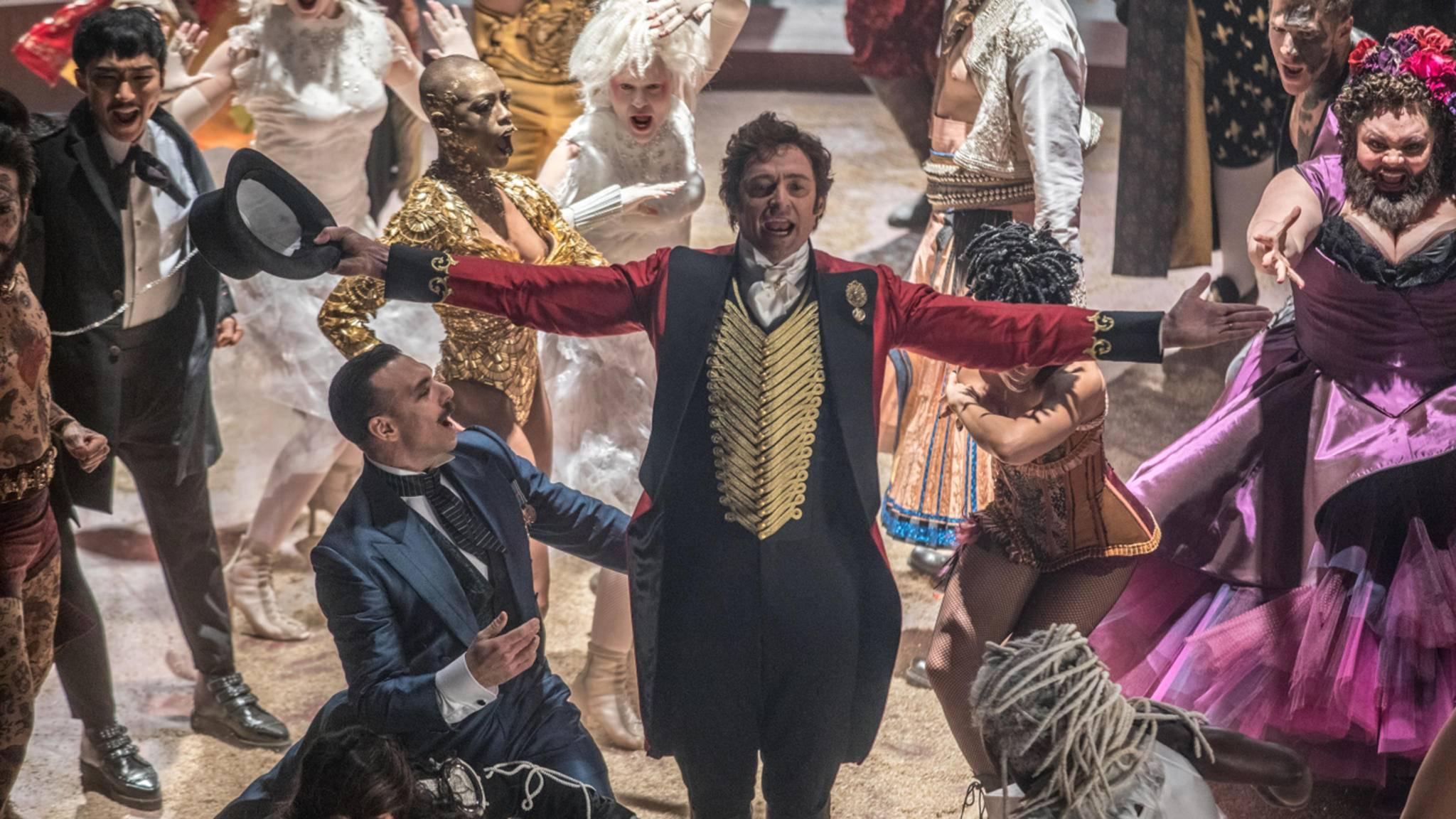 """""""This is the greatest Show!"""" Hugh Jackman hat in seinem neuen Musical-Film eine ganze Ladung Songs im Gepäck, die absolute Ohrwurmgarantie haben!"""