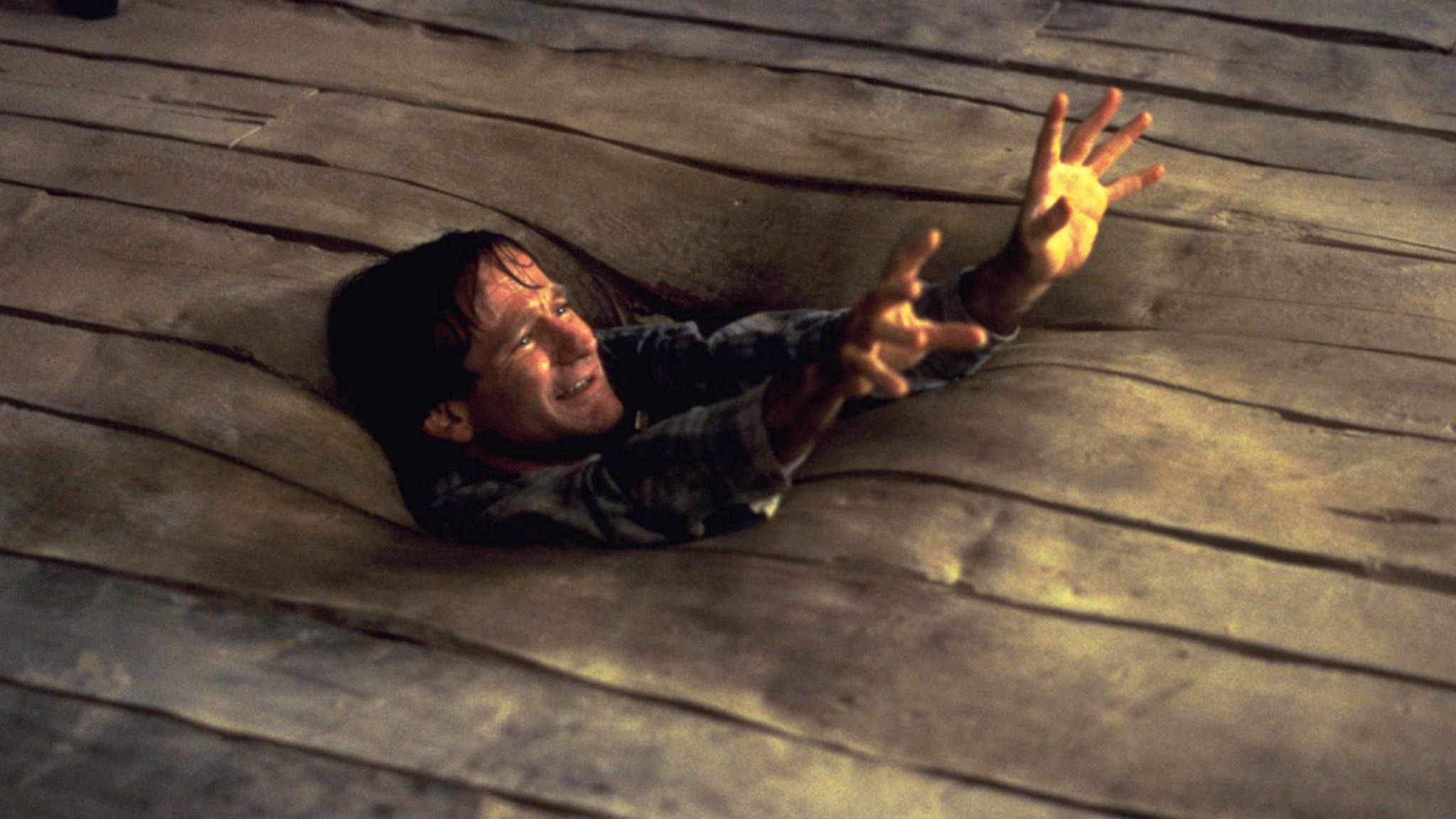 """Im Familienabenteuer """"Jumanji"""" wurde Robin Williams von einem Brettspiel verschluckt."""