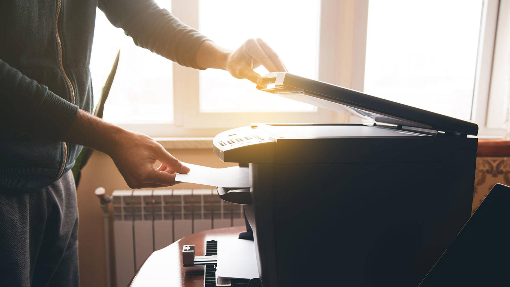 Praktisch als Kombi; Drucker, Scanner und Faxgerät im Homeoffice.