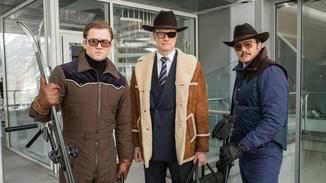 Eggsy, Harry und Whiskey (von links) tun sich bei der Jagd auf Poppy zusammen.